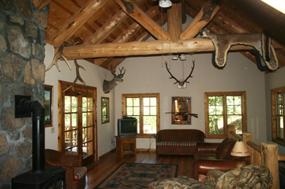 Grand view of the spacious lodge rock-walled main floor