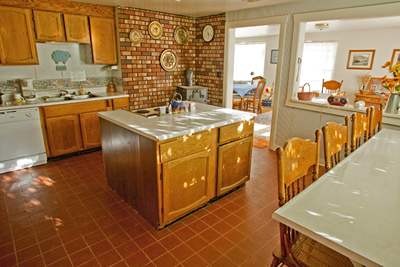 Equally spacious kitchen with the required amenities.