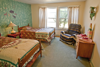 Two twin beds in a spacious double room.